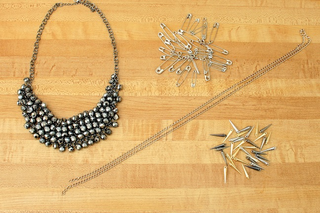 Sorelle in style diy punk statement necklace heres what youll need a mesh bib necklace safety pins spike beads and a gold link chain solutioingenieria Images