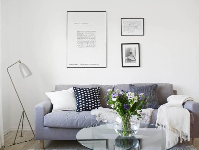 Salón estilo nórdico sofá gris