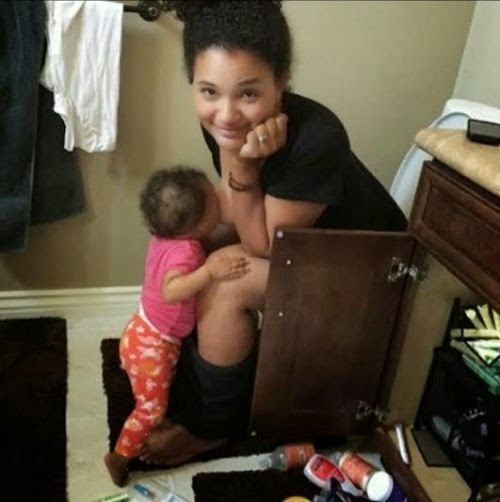 Viral picture of mum breastfeeding baby from the closet