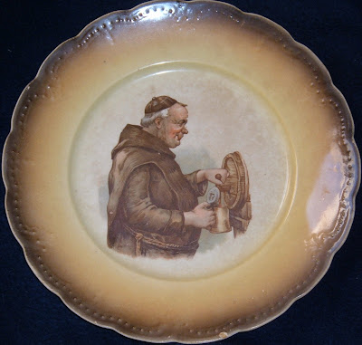 monk or friar having a beer, picture on a ceramic plate