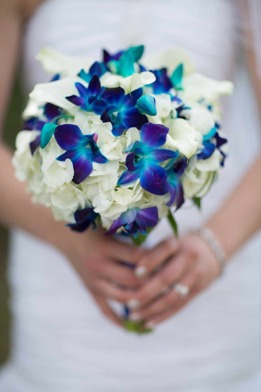 Bride in Bloom Blue orchid bouquet