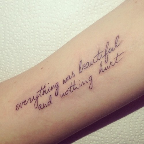 Arm tattoo writing