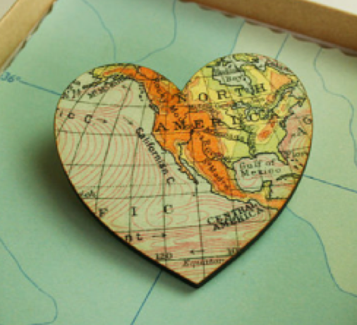 heart shaped map of world onto a wood base, north america