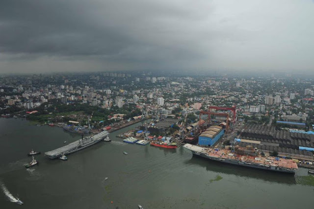 INS Viraat enters Cochin Shipyard for its final refit. Her replacement, the new Vikrant seen on right