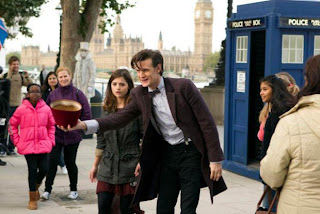 Doctor with Fez and Clara outside TARDIS