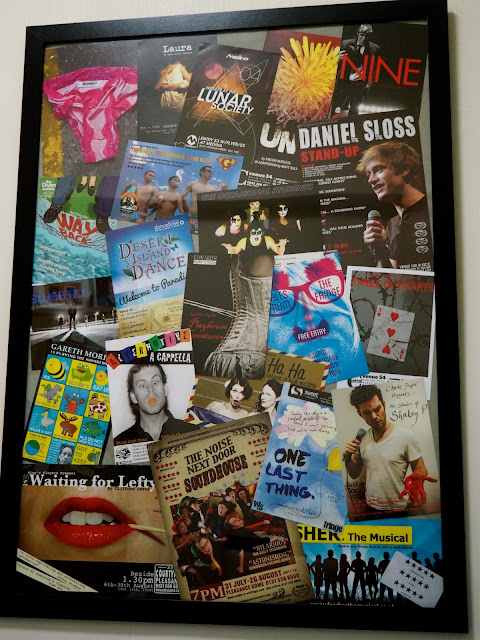 Room tour | collage of Edinburgh Fringe festival flyers in a picture frame in the bedroom of my Hong Kong apartment