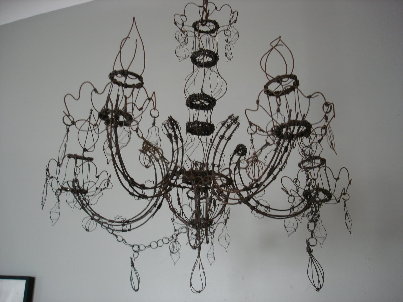 Insideways 0811 its hard to take a picture that does it justice but its a chandelier made of wire the wire isnt galvanized a coating that protects against oxidation arubaitofo Gallery