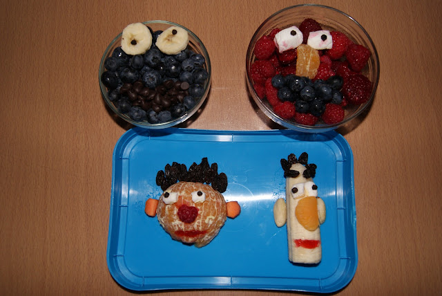 Cookie Monster, Elmo, Bert and Ernie made from fruit