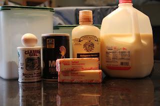ingredients for sugar cookies - flour, sugar, baking powder, egg, salt, butter, vanilla, milk