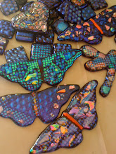 Fused dichroic glass pieces