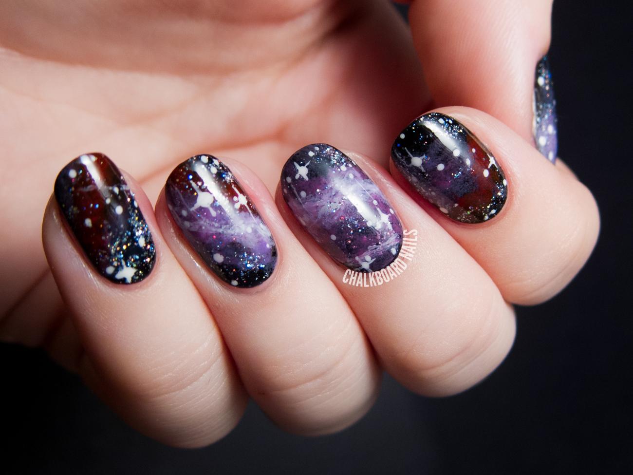 Pelican Nebula galaxy nail art by @chalkboardnails