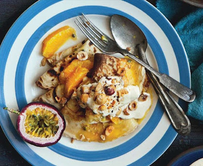 Breakfast crepes with orange and passionfruit compote