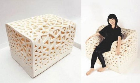 [The armchair that looks like a foam cube until you sit down on it. When seated, it looks like a normal armchair.]