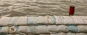 Foto Zandzakkenmuur. nieuwsbericht Onderzoek overstromingen Rijn ligt bij Deltacommissie. http://www.dub.uu.nl