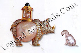 The rhinoceros and 'Asta' terrier brooches also feature baroque pearls and diamonds.