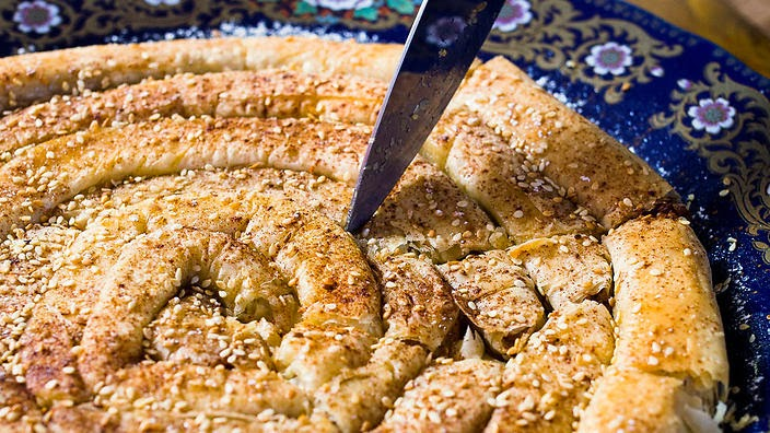 Moroccan almond pastry mhancha recipe for Arabic cuisine dishes