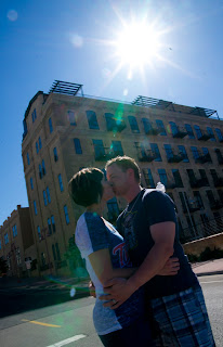 Stone Arch Bridge family photography shoot showing couple kissing under the sun