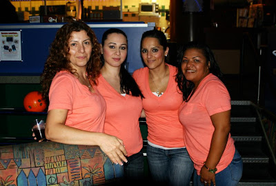 4 GotPrint staff members at bowling night with matching pink shirts