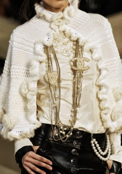 Chanel runway details: white and black outfit with necklaces