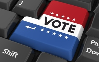 "Return key decorated as US ""Vote"" sign"