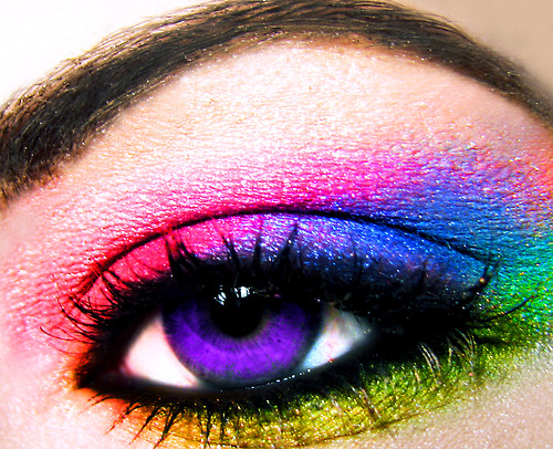 A purple eye with rainbow eyeshadow