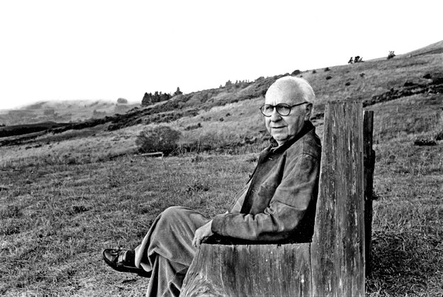 David Raksin sitting on a wooden park bench
