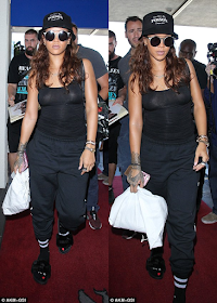 Rihanna shows off new right b00bs piercing
