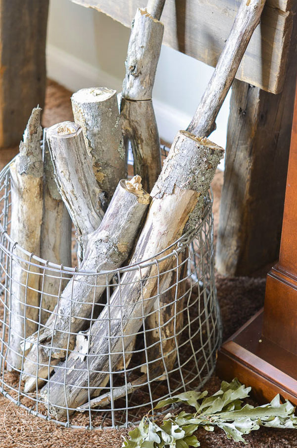 Unique metal kindling basket filled with logs.