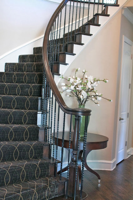 beautiful and luxury stairs with center rug