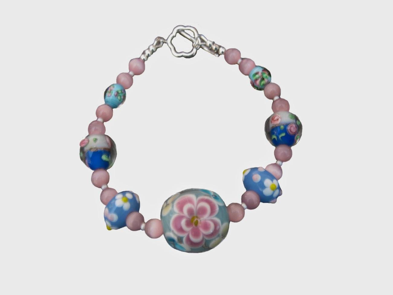 http://www.bonanza.com/listings/Lampwork-Bracelet-Sterling-Pink-Blue-Handmade/105793979