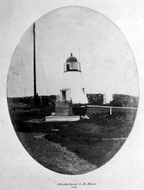 black and white photo of a white lighthouse on the shore of Lake Erie