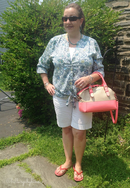 White Shorts Styled wiht a Printed Blouse
