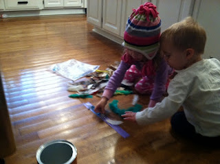 preschooler and toddler doing a thanksgiving turkey craft