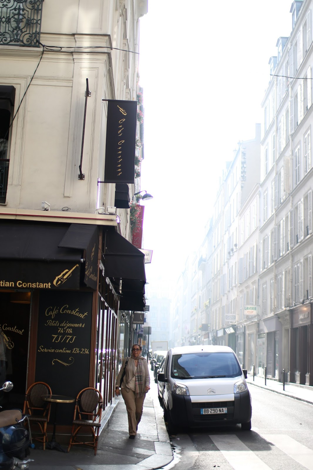 blowy light shining between the buildings in paris, photos of paris