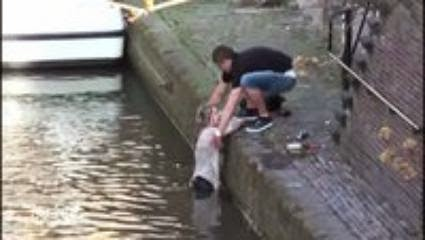 Tourists fall into canal