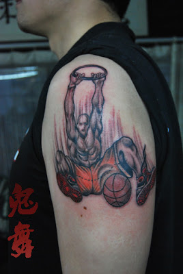 slam-dunking tattoo design on the arm
