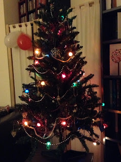 christmas tree with fairy lights and decorations - beads