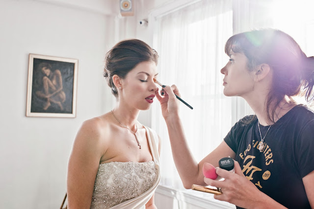 A Model Wedding, hair and makeup touch ups in the sunlight