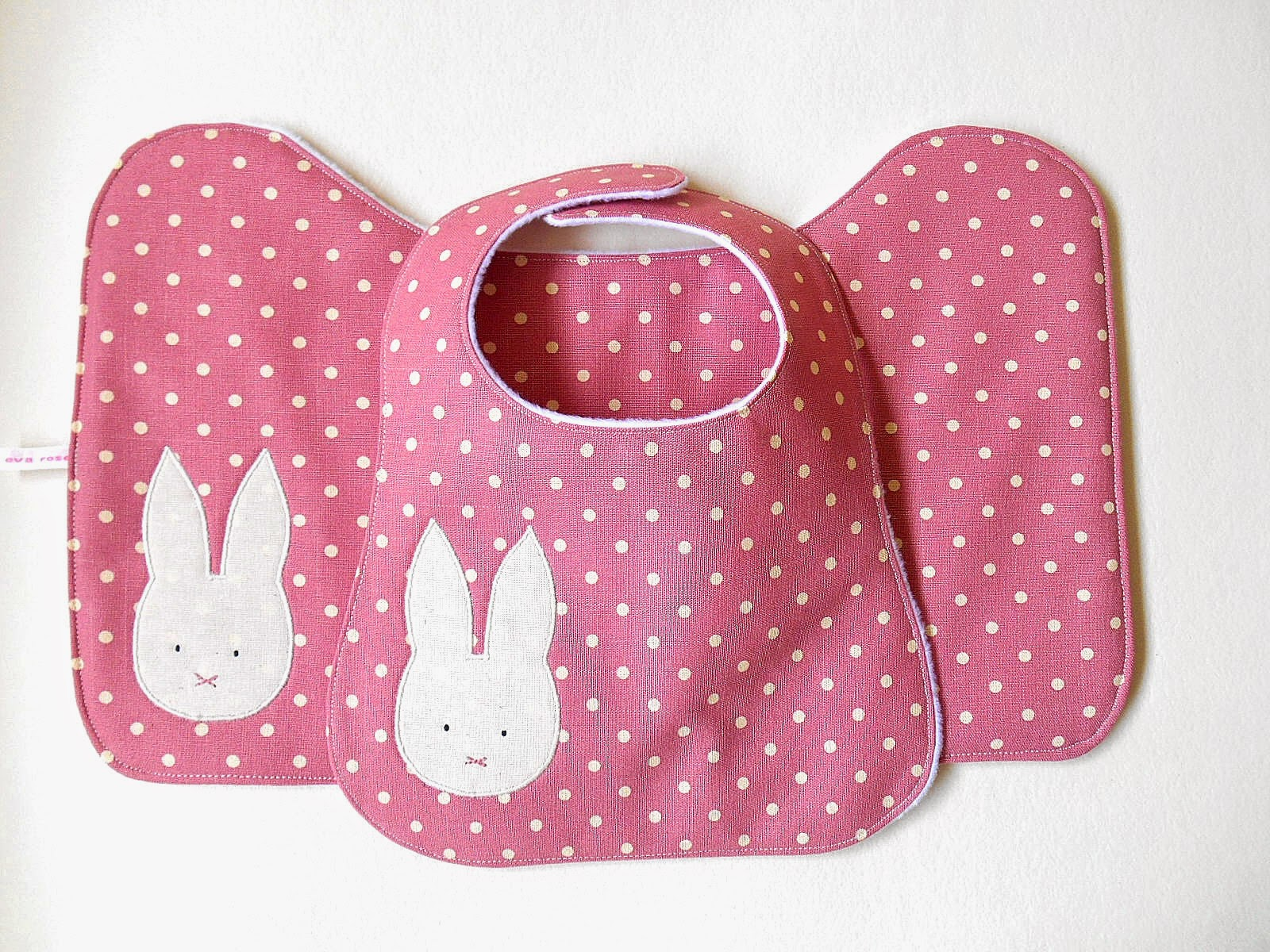 pink baby bib and matching burp cloth with bunny applique