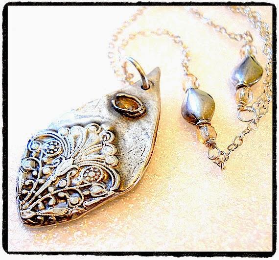 https://www.etsy.com/nz/listing/114663884/silver-victorian-teardrop-lotus-lace