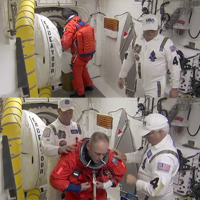 Astronauts of Mission STS-134 putting on their parachutes as they enter Endeavour. NASA 2011.