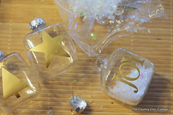 Gold Silhouette Ornaments -- make these simple Christmas ornaments using gold vinyl in just a few minutes.