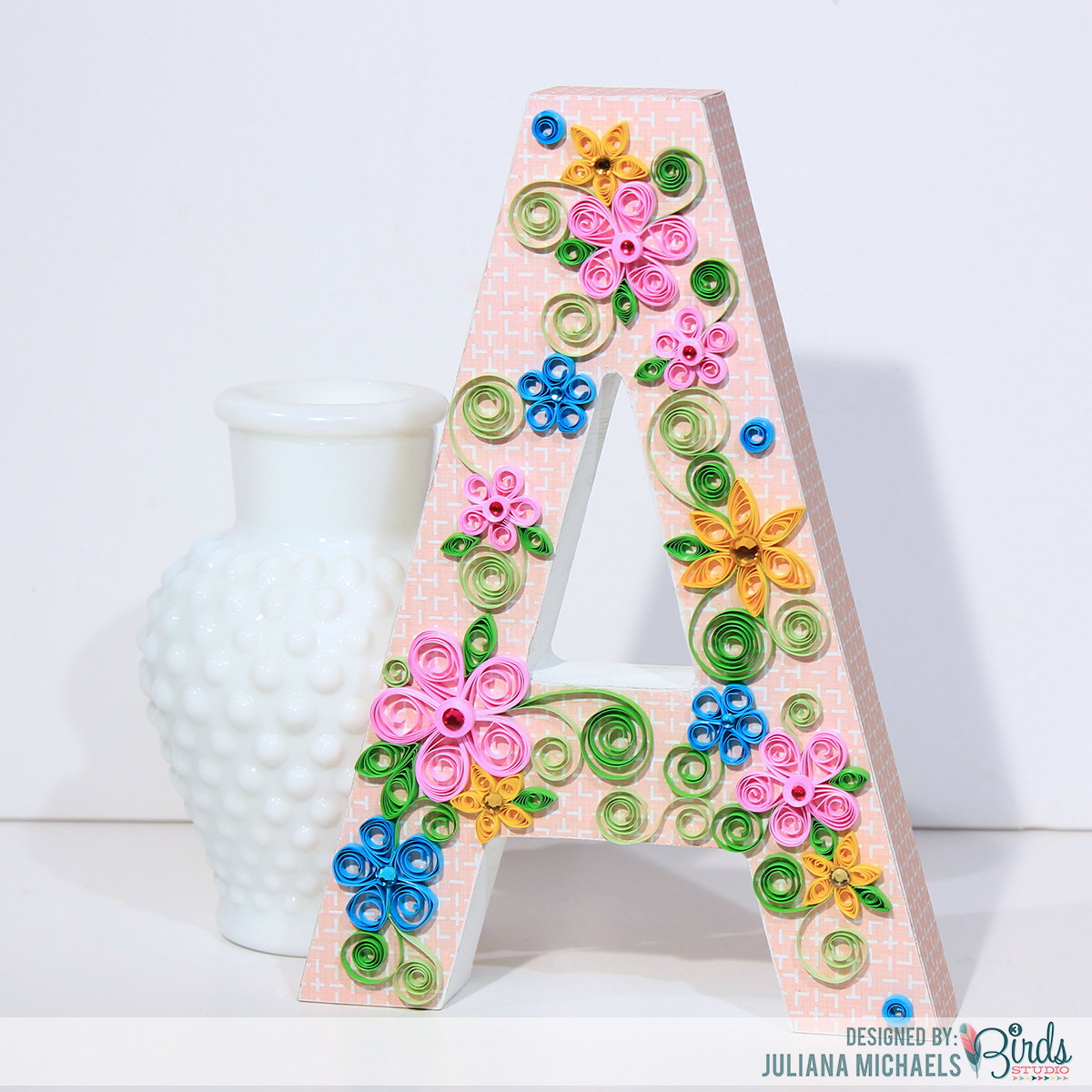 altered wood letter with patterned paper quilling