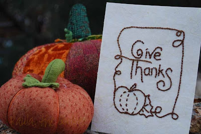 Photo of fabric pumpkins and embroidered greeting card