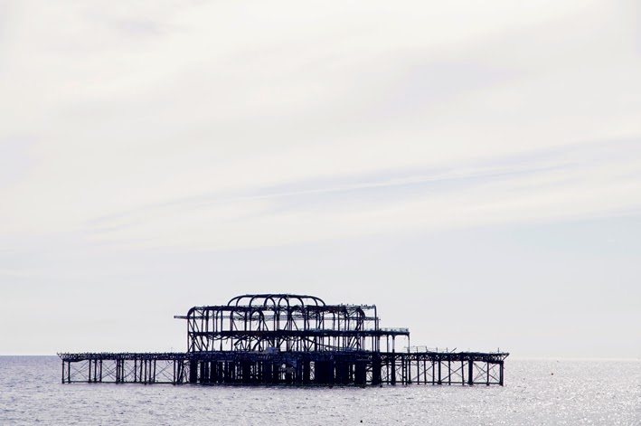 brighton old burned down pier like an island