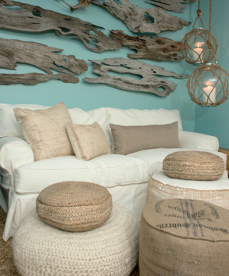 Coastal room with white slipcover, driftwood, rope and glass ball lanterns