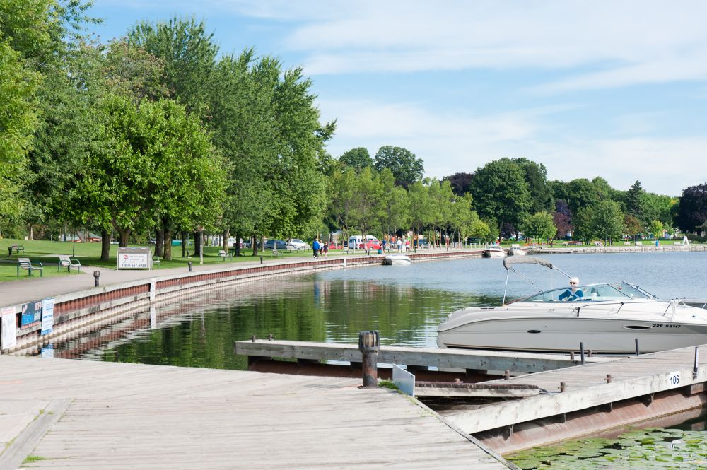 A familiar sight down at the Port of Orillia in the spring right through to fall; people in the park, and boats in the harbour.