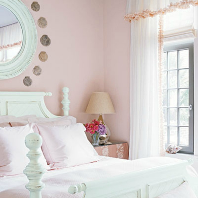 bed with light pink bedding and walls is a lovely shabby chic bedroom