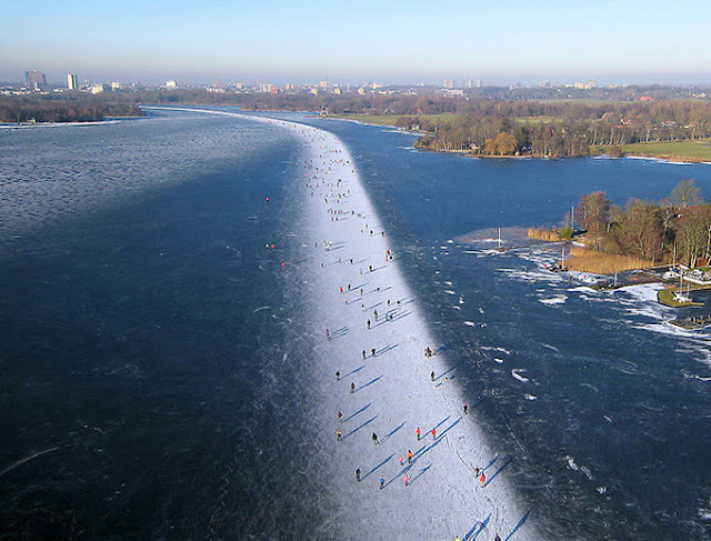 Ice skating on Paterswoldse Meer, a lake just South of the city of Groningen in the Netherlands