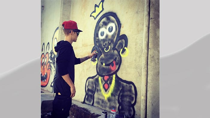 Justin Beiber In Hot Soup For Promoting Album By Writing Text On Roads, Walls (Photos)